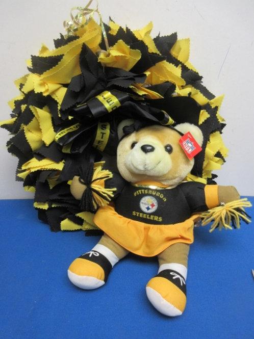 Pair of Steeler items, wreath and Steeler cheerleader teddy bear