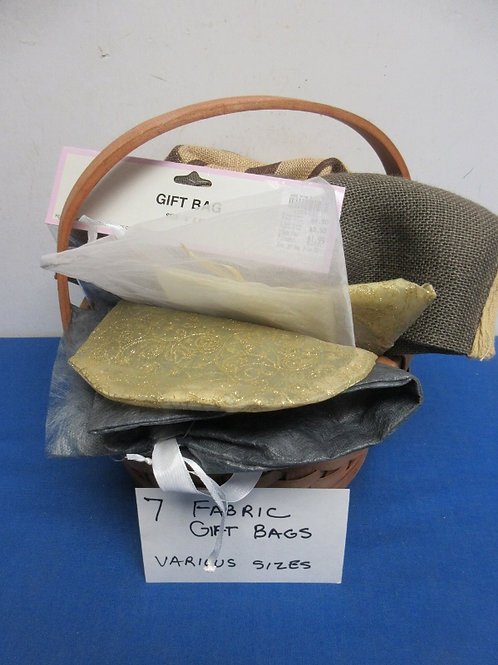 Set of 7 fabric gift bags in basket