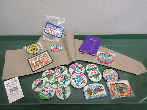 Set of Girl Scout items, book, badges, and sash