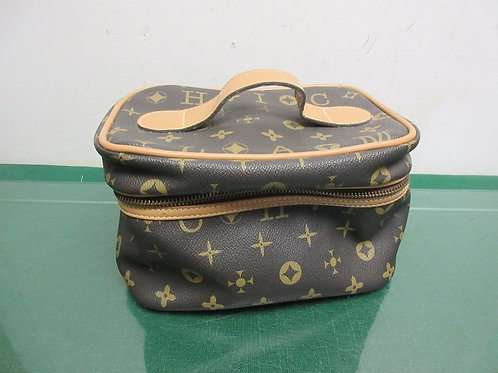 Small brown and tan rectangular cosmetic case