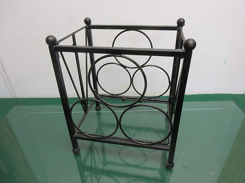 Small black metal table top wine rack, holds 3 bottles