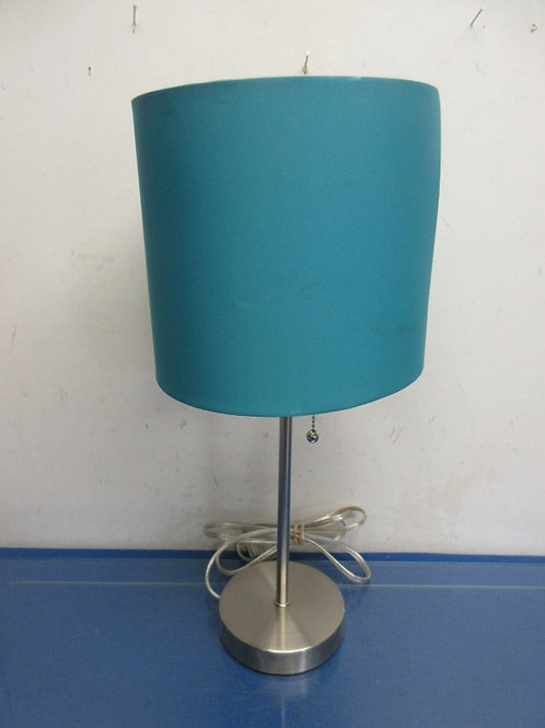 Silver pencil stick style lamp with turquoise shade