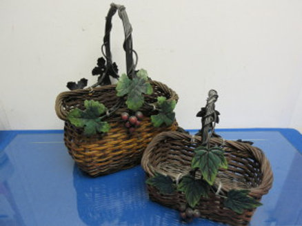 Set of 2 heavy woven baskets w/grape design and metal handles