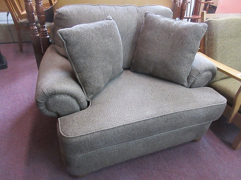 Brown oversized upholstered arm chair,