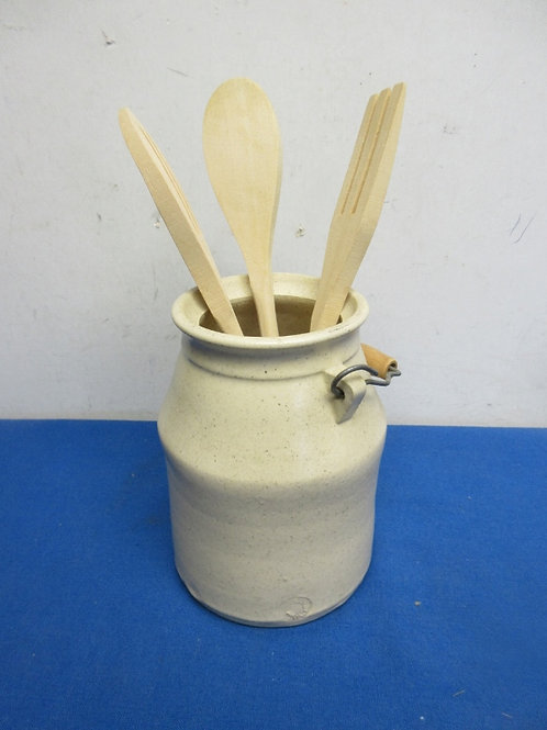 Ceramic utensil holder shaped like a milk jug with 3 wooden utensils