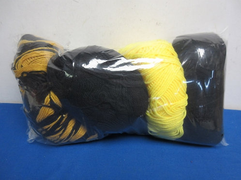 Small bag of black & gold yarn, over 4 skeins