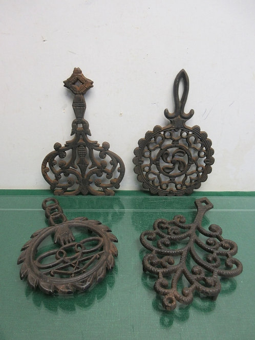 Set of 4 vintage cast iron Wilton footed trivets