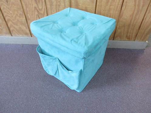Teal square collapsible storage cube with side pockets