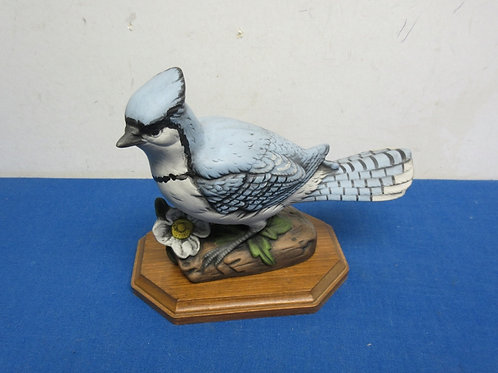 Bluejay statue on wooden stand