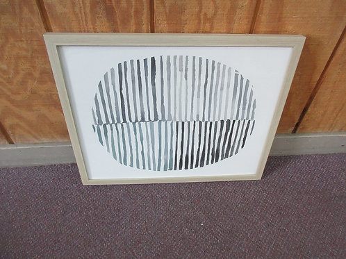 Abstract shades of gray and black stripes to form an oval, light tone wood frame