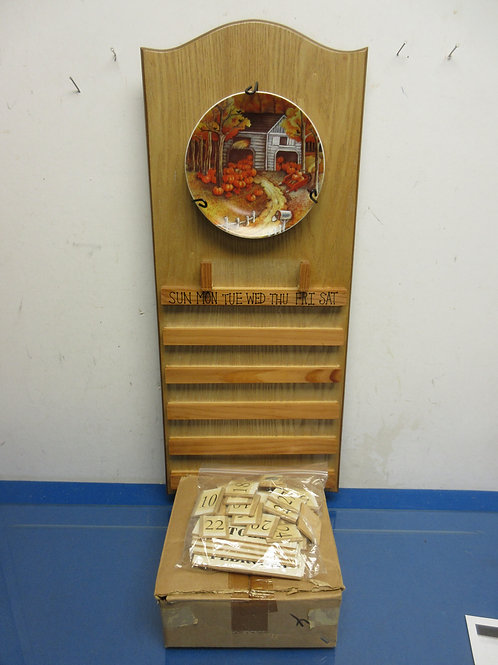 Perpetual changeable calendar with seasonal plates & number tiles