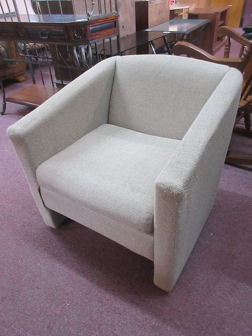 Small upholstered tan accent chair