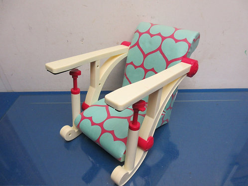 Baby doll booster seat-clips on a table for a tea party