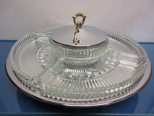 "Chrome and glass lazy susan,has 5 separate glass bowls 14"" dia."