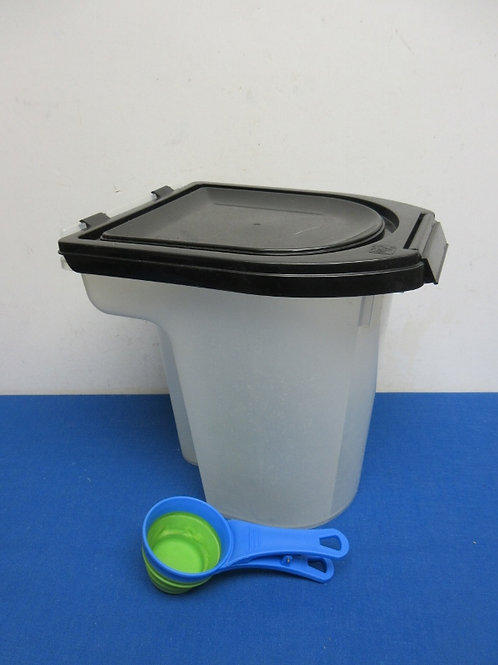 Clear pet food container with black lid and scooper