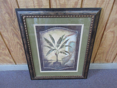 Print of potted plant at bottom of staircase with green mat - black & gold frame