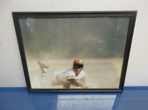 Colored action photo of Roberto Clemente in black frame 12 x 15