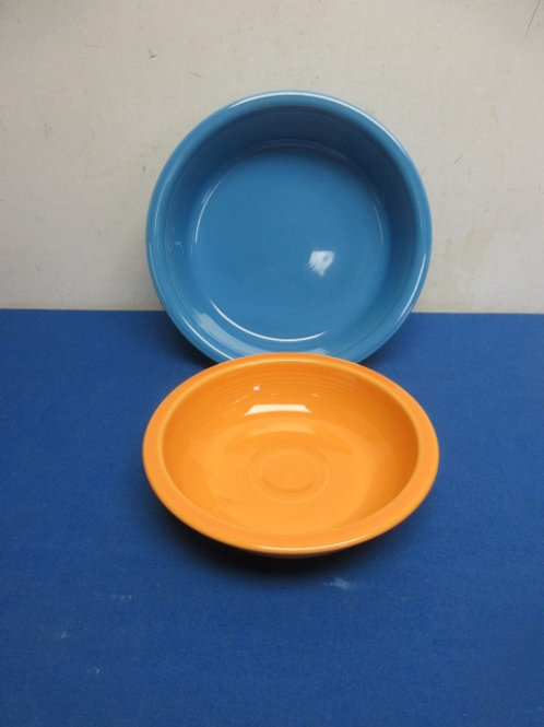 Fiestaware pair  of serving bowls large blue and small orange