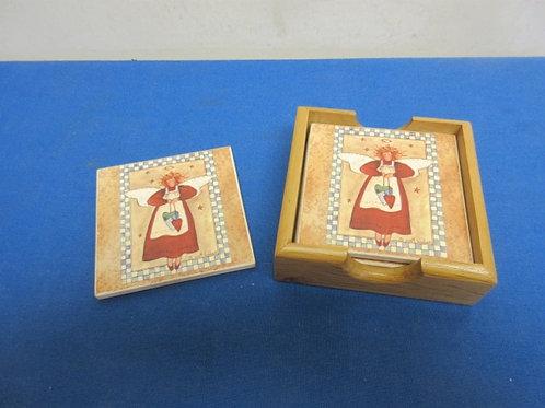 Set of 4 garden angel coasters in wooden holder