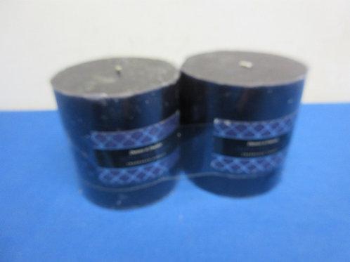 Pair of Darsee & David's navy blue pillar candles