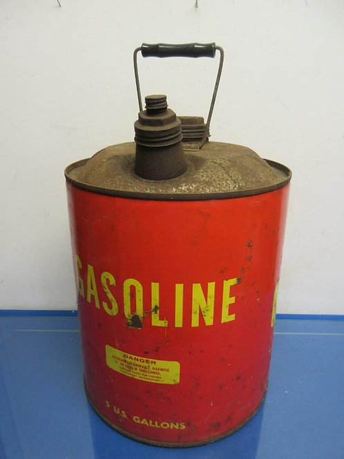 Vintage red metal 5 gallon gas can
