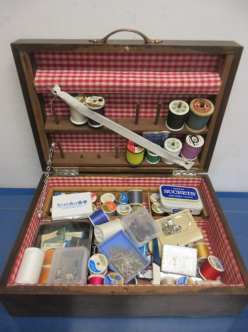Wooden box full of sewing supplies