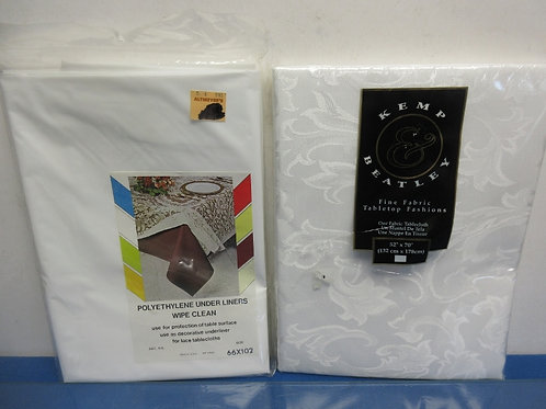 White fabric tablecloth 52x70 and a 66x102 plastic underlining - both new