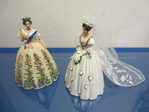 Pair of Queen Victoria resin statues, one is her wedding dress