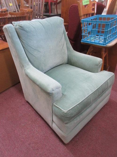 Light green upholstered arm chair