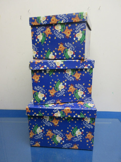 "Set of 3 blue ""seasons greetings"" nesting storage boxes with lids"