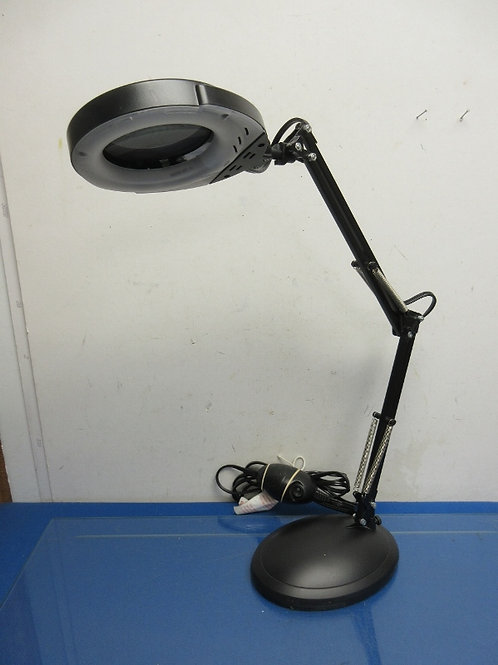 Black metal lamp with adjustable arm and magnifier attached