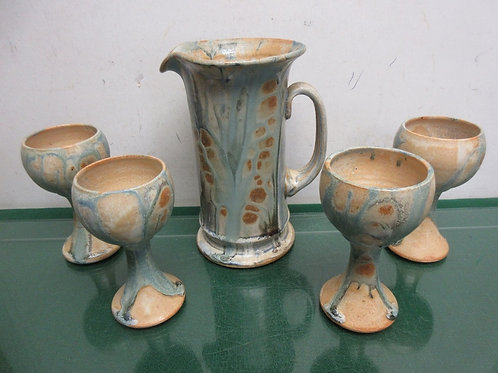 Handmade blue and brown pottery pitcher and 4 matching stemmed goblets