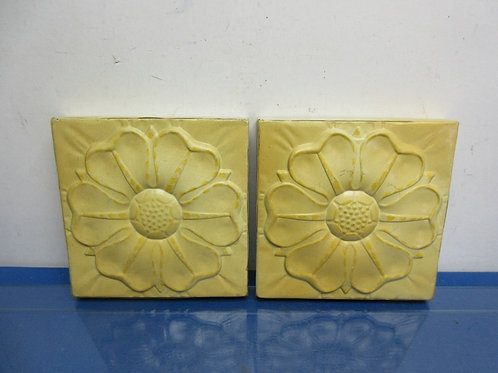 Pair of yellow metal wall plaques