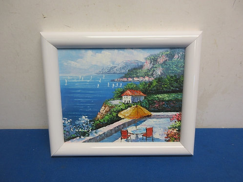 Oil painting print of patio over looking sailboats in white frame 10x12