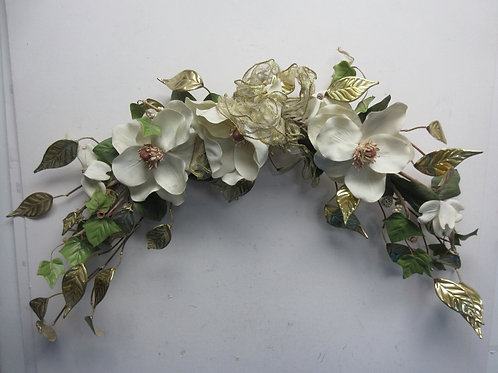 Floral magnolia arch with gold metal leaves