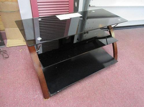"Medium size 3 tier black glass TV stand w/wood side rails 20x40x21""high"
