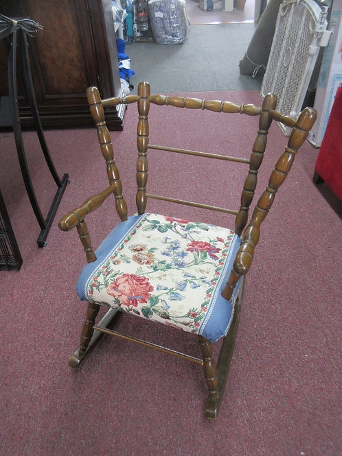 Child size wood rocking chair with floral upholsted seat