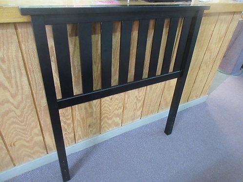 Black slat style wooden twin headboard