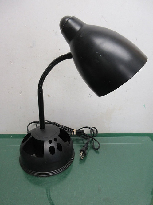 Black desktop lamp with flexible arm and organizing base