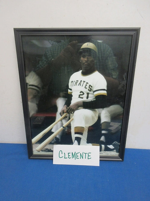 Colored photo of Roberto Clemente on deck in black frame - 12x15