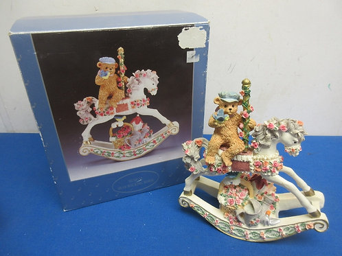 """Musical bear on an ornate rocking horse, plays """"Memory"""""""