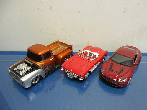 Set of 3 diecast cars-red Aston Martin, red Corvette, and rust colored pick up