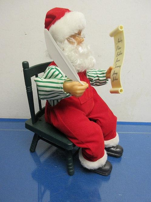 Musical santa checking his list sitting on a green chair