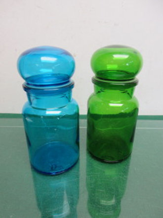"""Pair of colored glass sealing jars, one blue, & one green, each 7""""high"""