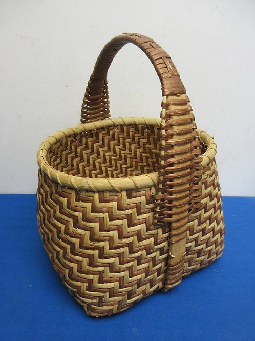 Woven brown and tan square wicker basket with handle