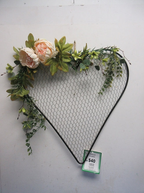 Metal chicken wire heart with floral accents