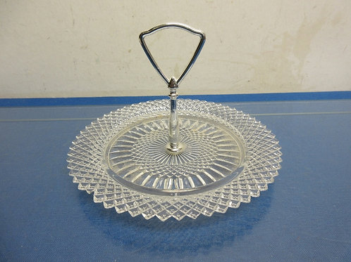 Vintage glass serving plate with connected chrome handle in the middle