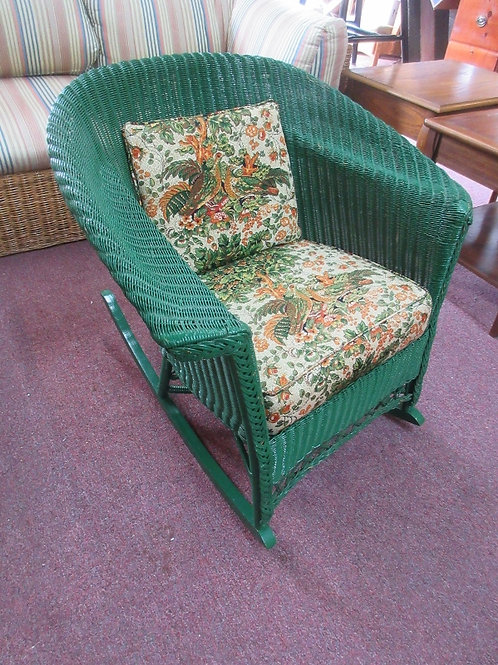 Green painted wicker rocking chair with seat and back cushions