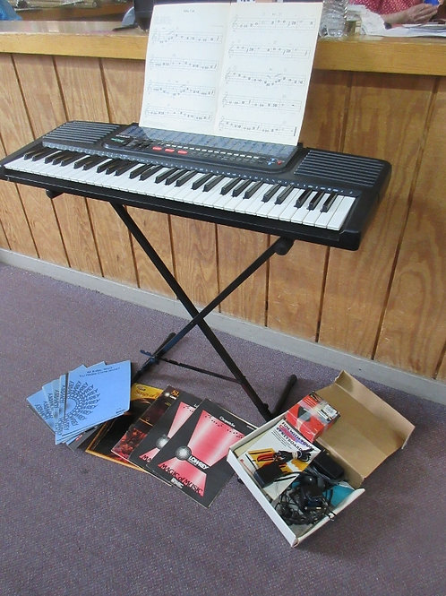 Casio tone bank ct638 keyboard with music books, stand and foot pedal