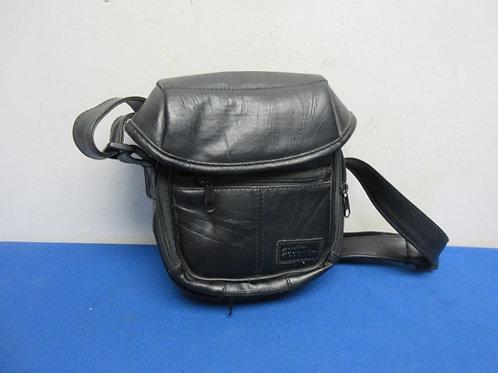 Small black purse with adjustable shoulder strap
